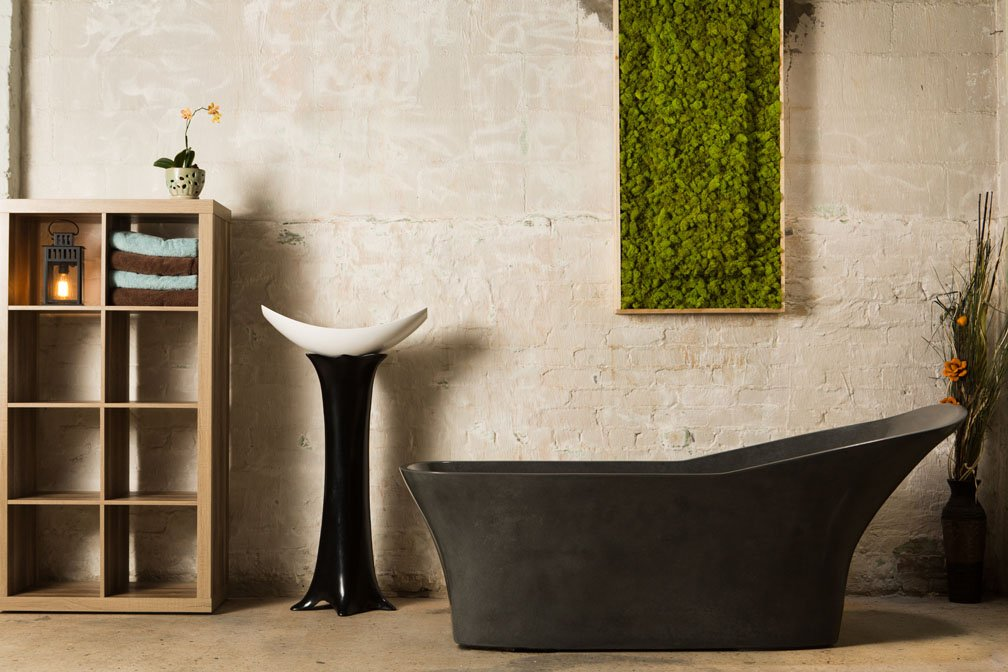 Igneous flagship luxury concrete soaking tub in a rustic bathroom